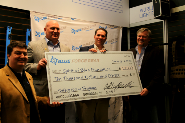 Image Caption – Blue Force Gear presented the Spirit of Blue Foundation with a $10,000 check at the annual SHOT Show on January 17th. Accepting the gift for the Spirit of Blue were (left to right) Andrew Heltsley, Treasurer; Todd Parola, Chairman; Ryan T. Smith, Executive Director. The gift was presented by Ashley Burnsed, CEO of Blue Force Gear (far right).