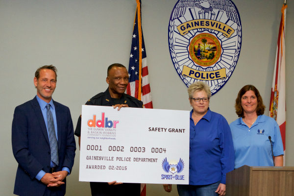 Image Caption – The Spirit of Blue safety training grant was presented at the Gainesville Police Headquarters Building on February 24th. In attendance were (from left to right) Jeffrey Weisberg of the River Phoenix Center for Peacebuilding; Chief Tony Jones of the Gainesville Police Department; and Board Members Diane Harbour and Sue Post of the Spirit of Blue Foundation.