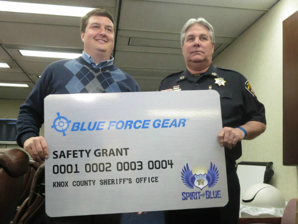 "Image Caption - Andrew Heltsley, Secretary for the Spirit of Blue Foundation (left) presented a Safety Equipment Grant to Sheriff Jimmy ""J.J."" Jones of the Knox County Sheriff's Office (right) providing 100 C-A-T Tourniquets and carrying straps for KCSO officers in a ceremony on March 24, 2014."