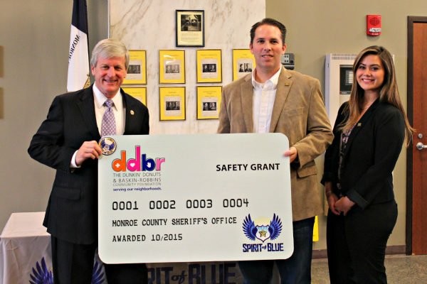 Image Caption – Sheriff Patrick O'Flynn (left) accepted the Safety Equipment Grant at a ceremony held at the Monroe County Sheriff's Office Headquarters in Rochester, NY. Presenting the grant was Ryan T. Smith, Executive Director of the Spirit of Blue Foundation, and Abbey Celeste, Field Marketing Manager from Dunkin' Brands.