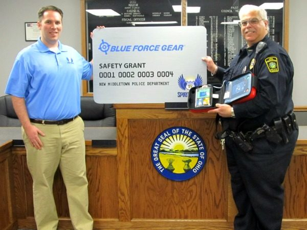 Image Caption - Ryan T. Smith, Executive Director of the Spirit of Blue Foundation (left), presented the New Middletown Police Department with a Philips HeartStart AED. Receiving the grant was Chief Vincent D'Egidio (right) at the City Municipal Building on February 25, 2014.