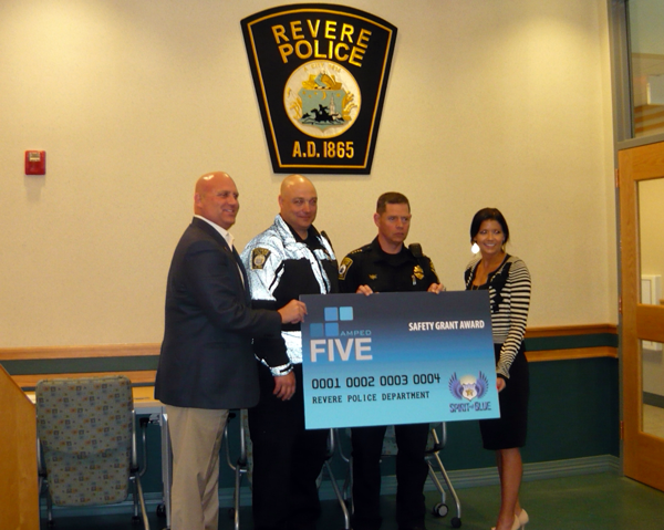 Image Caption - A formal presentation of the Amped Five Safety Equipment Grant was made to members of the Revere Police Department at their headquarters facility on April 25, 2013. At the presentation were (left to right) Todd Parola, Spirit of Blue Chairman of the Board and co-founder; Patrolman David Wilson and Chief Joseph Cafarelli of the Revere Police Department; and Melissa Parola, Spirit of Blue Vice-Chairman for Operations and co-founder.