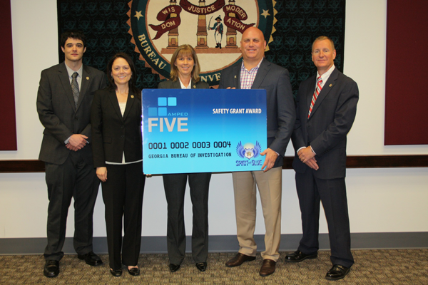Image Caption - The Amped FIVE software was presented at the GBI headquarters on May 10, 2013 by Todd Parola (second from right) Co-Founder and Chairman of the Board of the Spirit of Blue Foundation. Representing the Georgia Bureau of Investigation (from left to right) were Digital Forensic Investigator Matthew Heath, Assistant Special Agent in Charge Cynthia Adkins, Digital Forensic Investigator Supervisor Beth Messick, and Deputy Director Rusty Andrews.