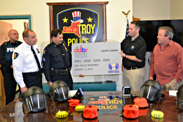 Image Caption – Receiving the Spirit of Blue Safety Equipment Grant (left to right) were Chief John Tedesco and Sergeant Sam Carello of the Troy Police Department. Presenting was Ryan T. Smith, Executive Director of the Spirit of Blue and Ivo Garcia, Dunkin' Donuts Franchisee Owner in the Troy area.