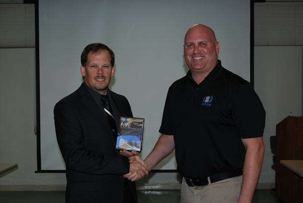 Image Caption - Lt. Doug Seely (left), representing the Winter Springs Police Department, is a senior member of their Criminal Investigations Bureau. The Amped FIVE Software was presented by Todd Parola (right) Co-Founder and Chairman of the Board of the Spirit of Blue Foundation.
